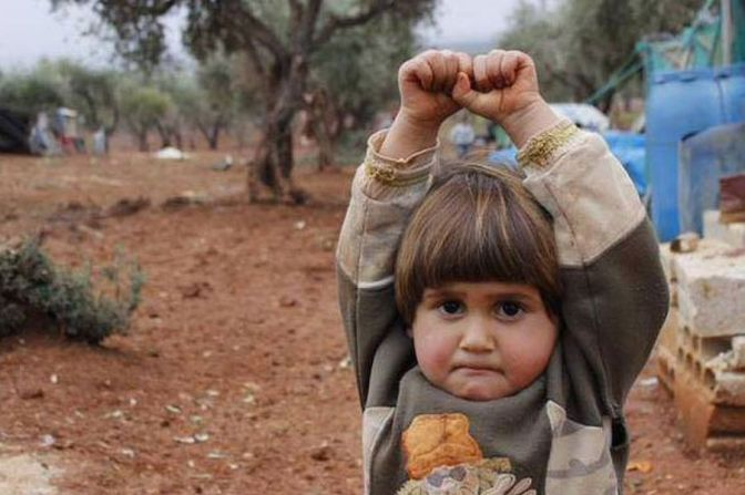 girl syria camera surrender